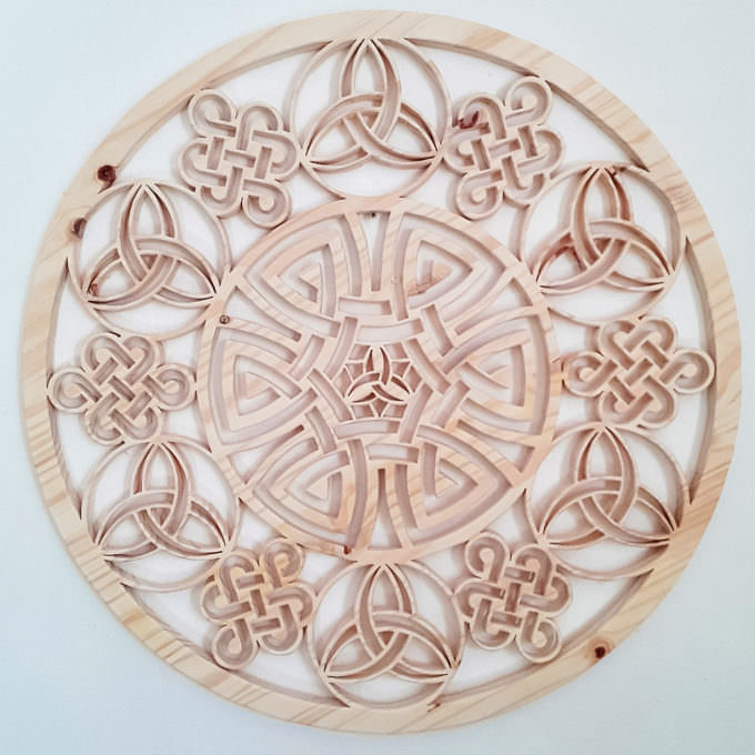 Wooden art celtic mandala with custom design on white wall