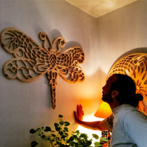 Handmade wooden art dragonfly mandala with custom design and unique pattern mounted on wall